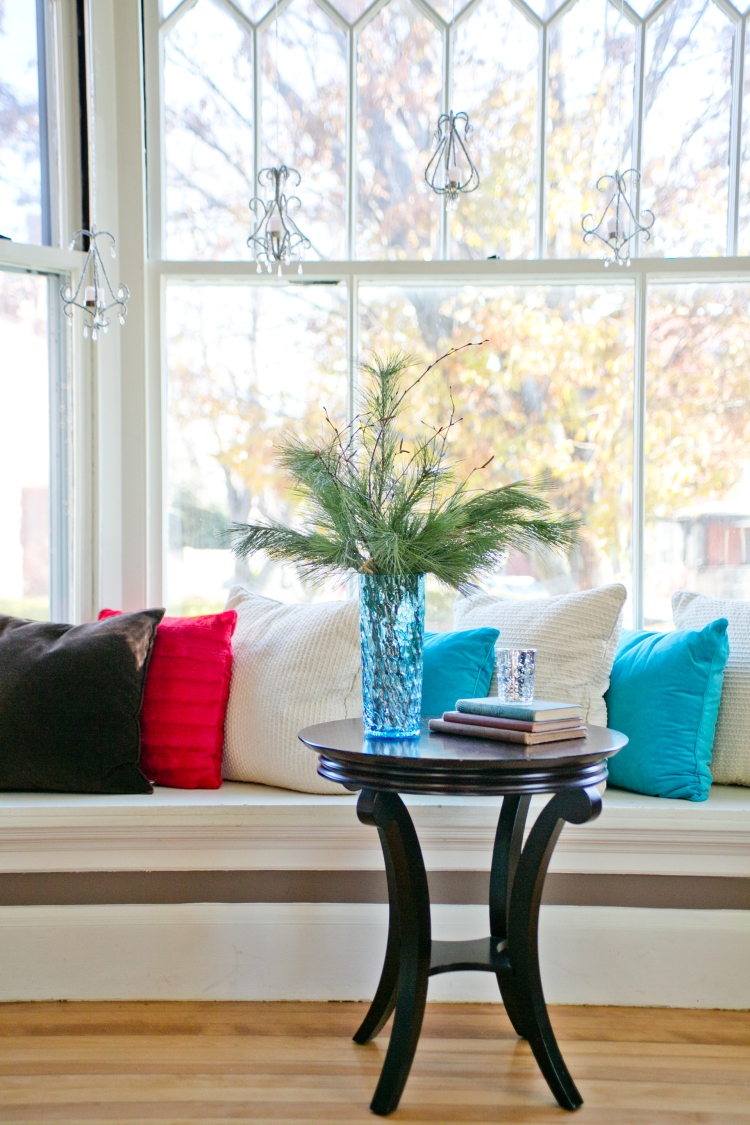 Window seat and mini votive chandeliers
