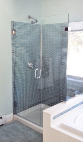 photo of glass tile shower and frameless shower doors