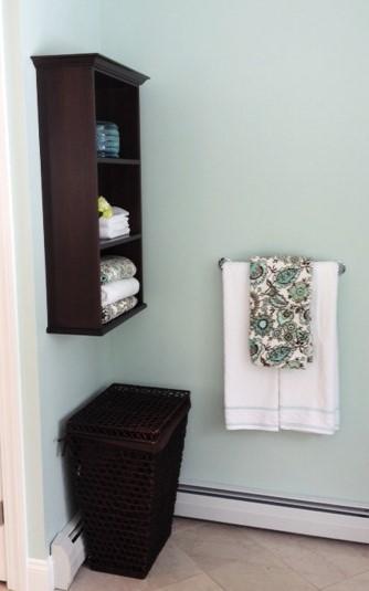 photo of custom open shelf unit, towel bar and hamper
