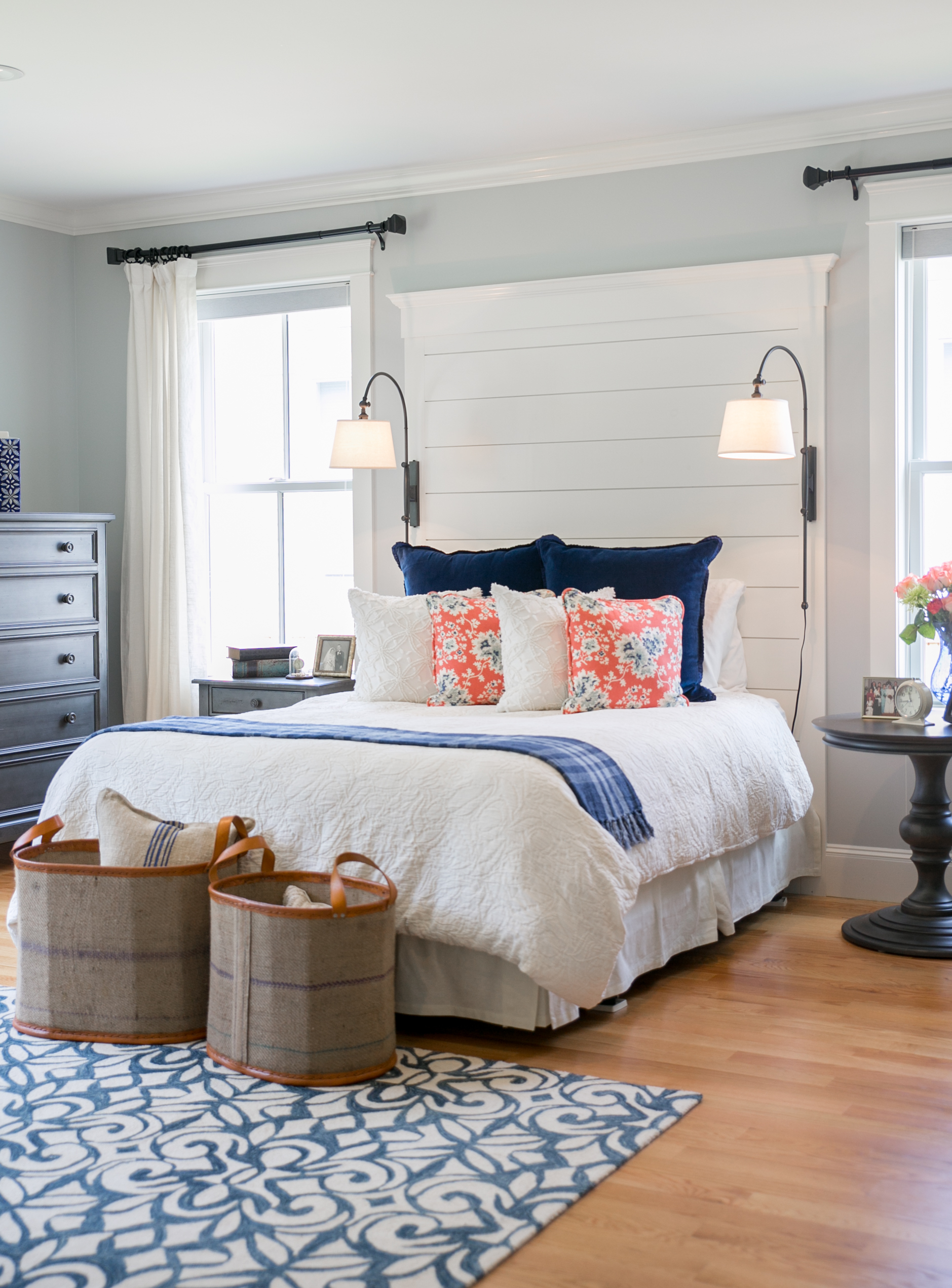 Navy coral and cream master bedroom with
