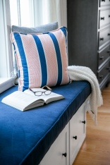 photo of navy cushion on window seat