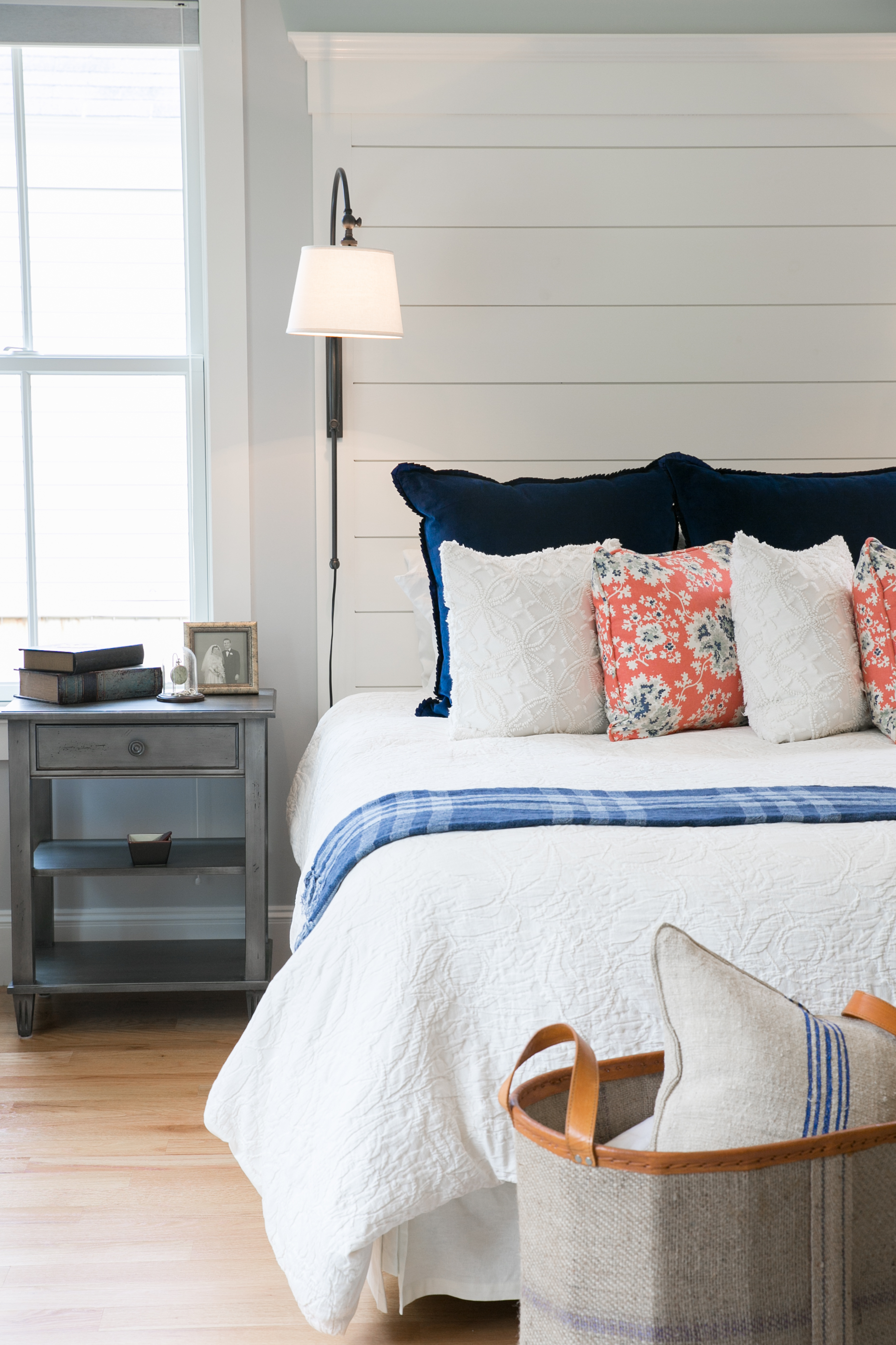 navy coral and cream master bedrrom with shiplap
