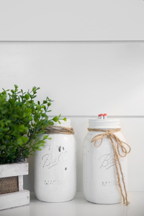 photo of shiplap wall and mason jars