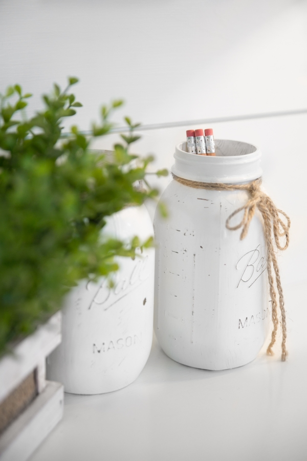 photo of painted mason jars and shiplap wall