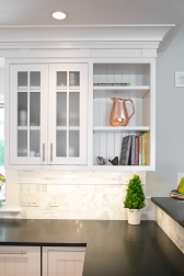 photo of glass door cabinets and open shelf