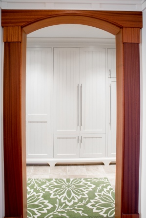 Photo of mahogany archway looking into pantry and mudroom