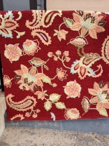 Photo of red paisley area rug