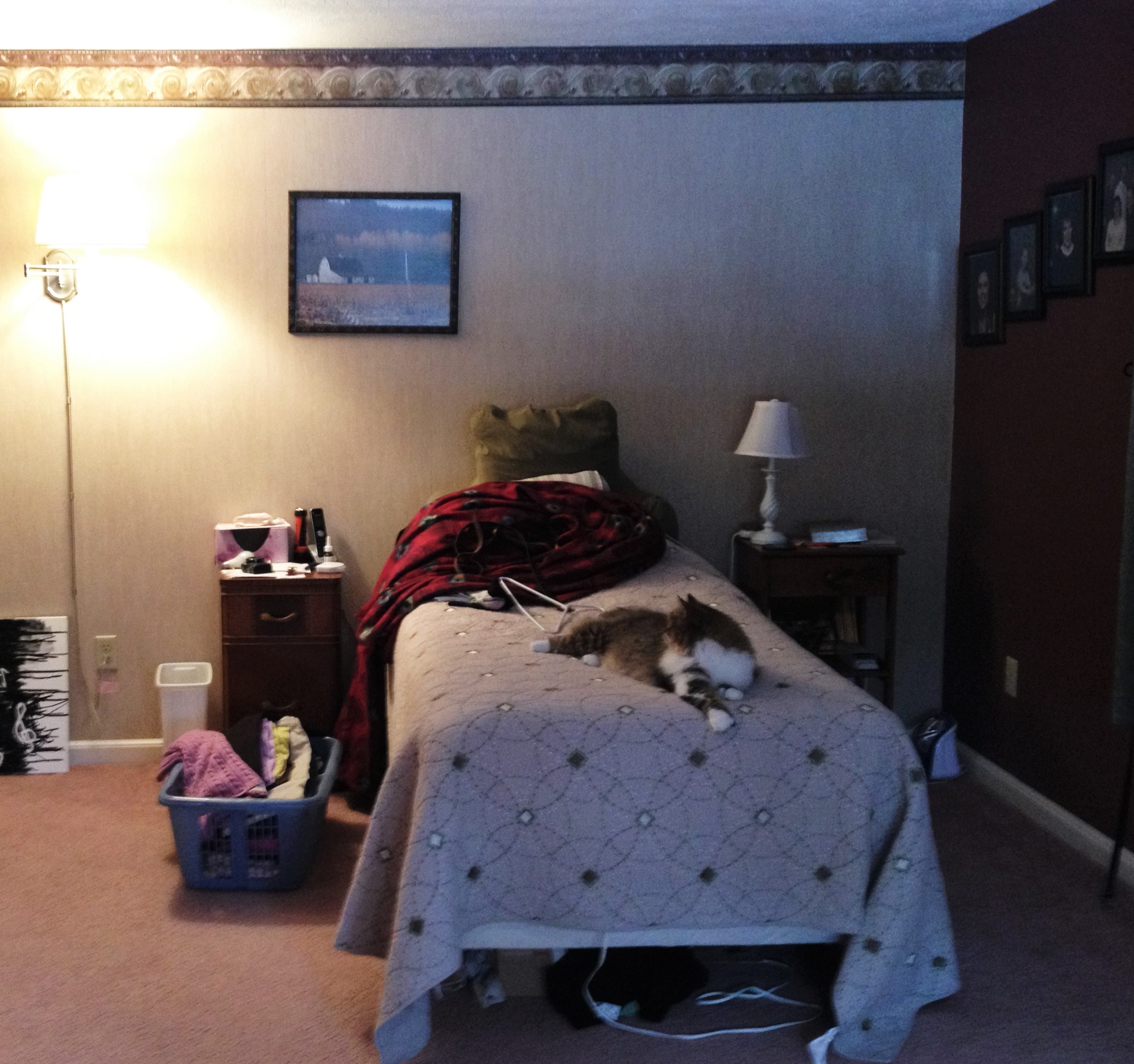 photo of bed and outdated paint and wallpaper