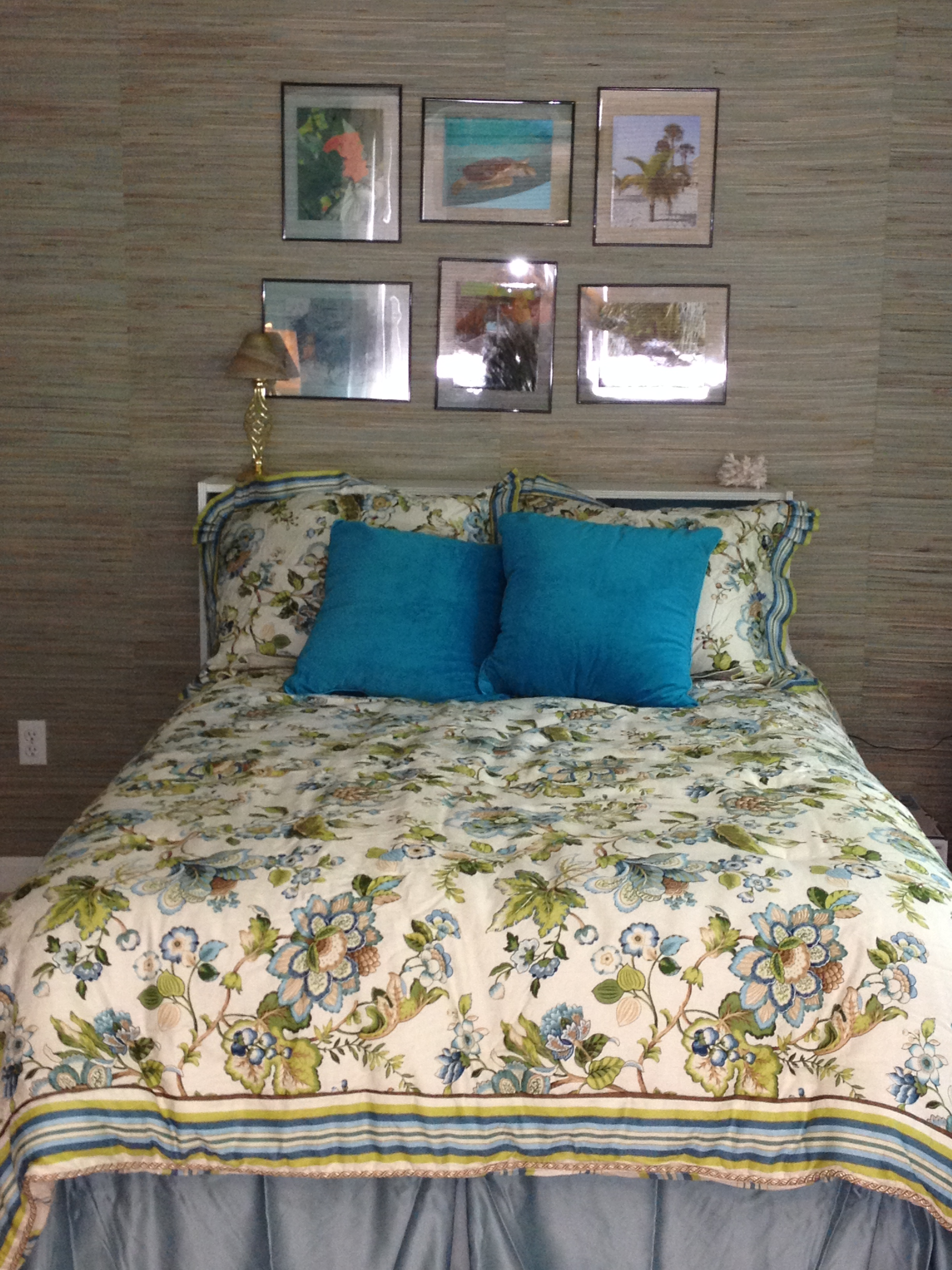 photo of bed against grasscloth wallpaper wall with frameless floating photos