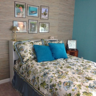 Photo of bed, bedding and grasscloth wallpaper