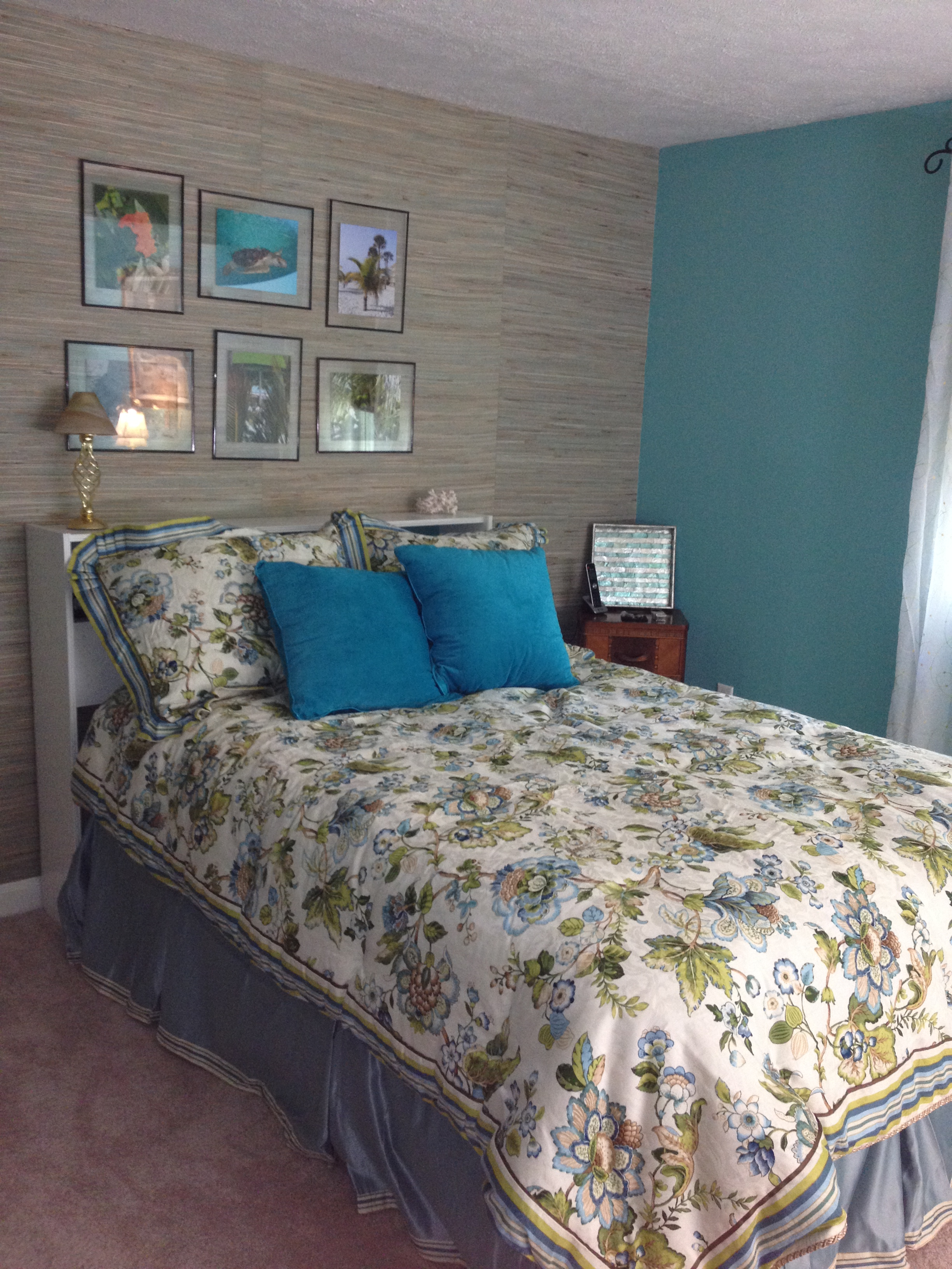 photo of bed and grasscloth wallpaper wall