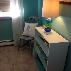 photo of vintage chair and pillow and ombre painted bookshelves