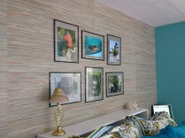 photo of grasscloth wallpaper and floating frame photos