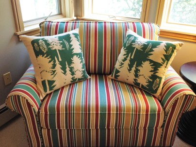 Photo of pine tree pillows and striped chair