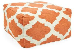 photo of orange geometric ottoman
