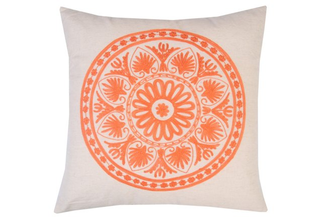 photo of orange embroidered pillow