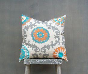 photo of orange grey aqua pillow