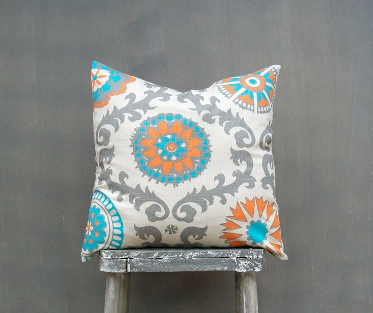photo of orange grey aqua pillow