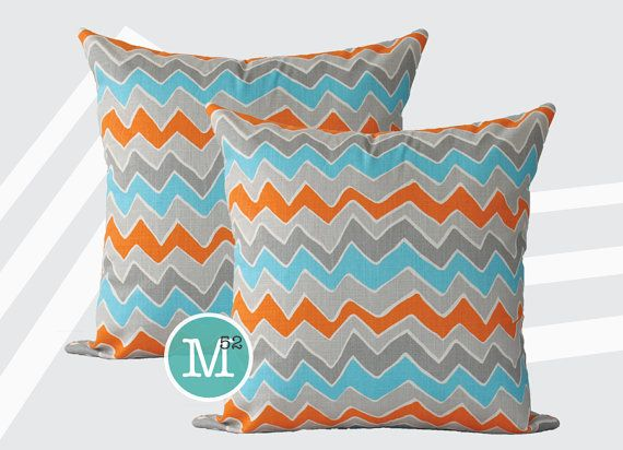 photo of orange grey aqua pillows