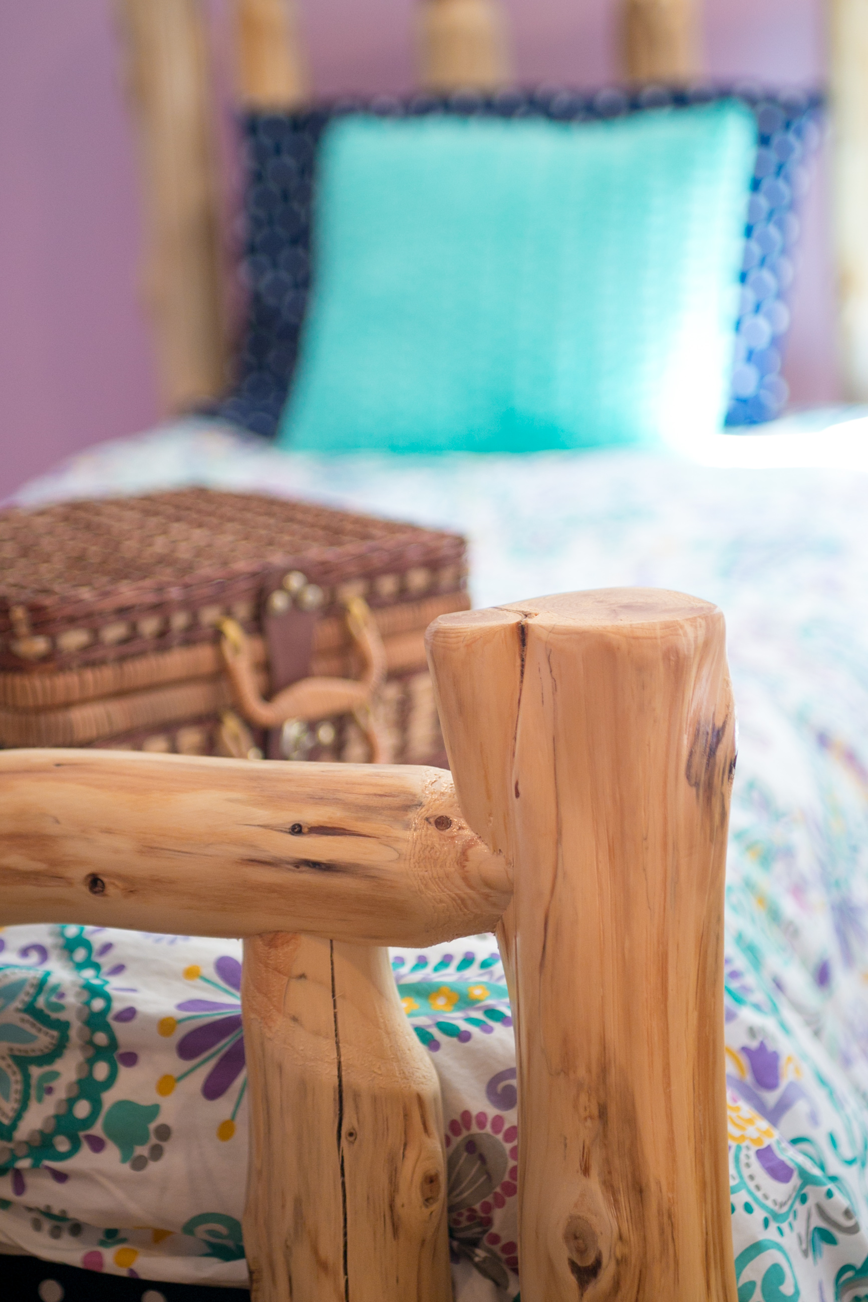 photo of pine log bed and bedding